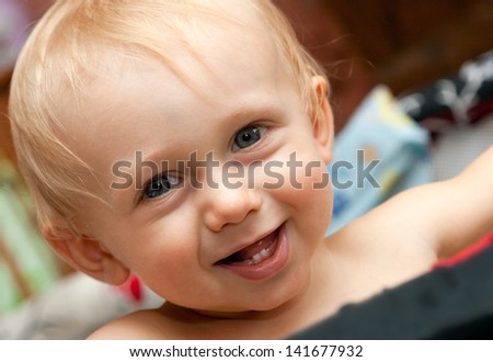 First teeth in a young boy's mouth. Happy child.