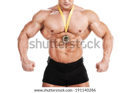 Firts place. Muscular man with gold medal - stock photo