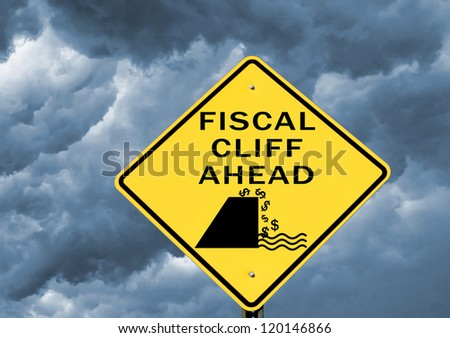 Fiscal cliff warning sign on stormy background - stock photo