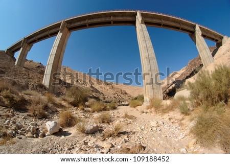 Fisgeye view of bridge in the desert - stock photo