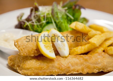 Fish and Chip with green salad - stock photo