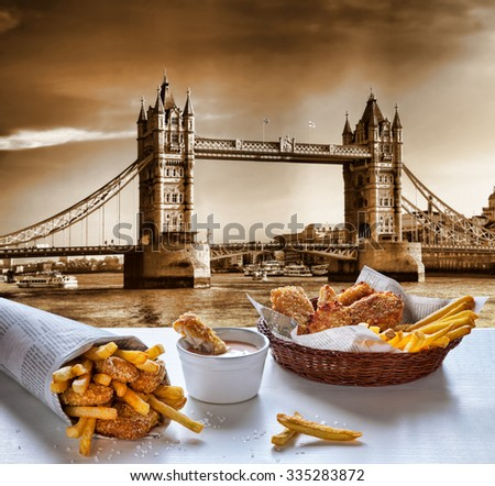 Fish and Chips against Tower Bridge in London, England - stock photo