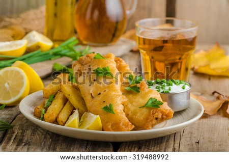 Fish and chips. Fish wrapped in beer batter, herbs dip and czech beer - stock photo
