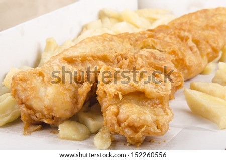 fish and chips in a white box