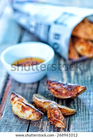 fish and chips on the wooden table - stock photo