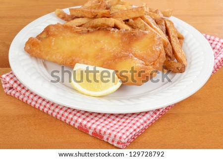 fish and chips with lemon - stock photo