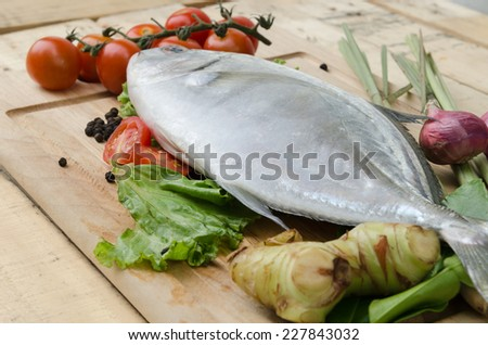 fish and vegetables on kitchen board