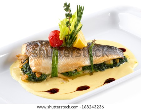 fish baked and decorated - stock photo