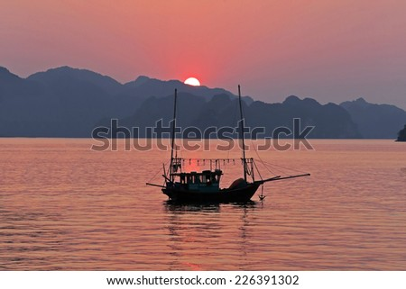fish boat at Late afternoon in Halong Bay,Vietnam - stock photo