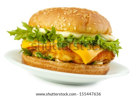 Fish burger with breaded patty and mayonnaise on dish, isolated on white with shadow - stock photo