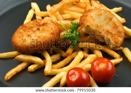 Fish Burger with fried chips on a pan - stock photo