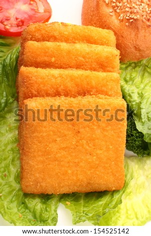 Fish burger with vegetables. - stock photo