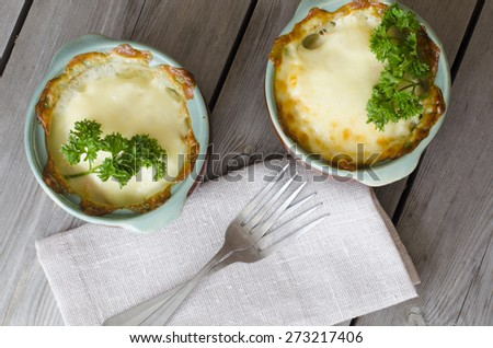 Fish casserole with vegetables in white sauce - stock photo
