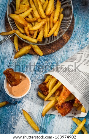 Fish & Chips served traditionally in the newspaper - stock photo