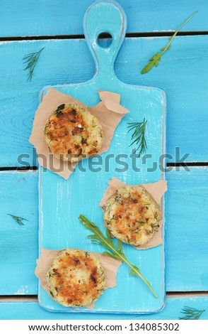 fish croquette on the blue catching board - stock photo