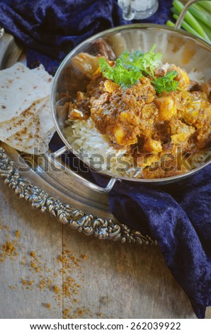 fish curry with rice served in tradition indian bowl. selective focus - stock photo