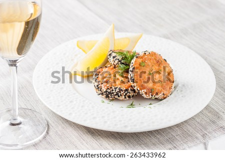 Fish cutlets breaded in sesame. Salmon burgers - stock photo