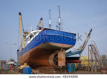 Fish cutter repaired at a dutch shipyard - stock photo