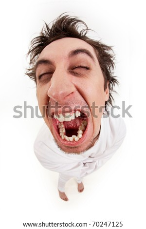 Fish eye shot of screaming insane man in strait-jacket in isolation - stock photo
