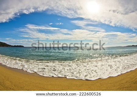 Fish eye view of a beautiful sandy beach at small greek village Toroni, Sithonia, Greece - stock photo