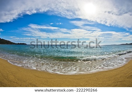 Fish eye view of a beautiful sandy beach near small greek village Toroni, Sithonia, Greece - stock photo