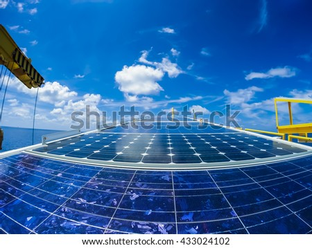Fish eye view of oil and gas wellhead remote platform,DC power generation from solar cells at flare bridge for charging platform battery,sunlight energy.  - stock photo