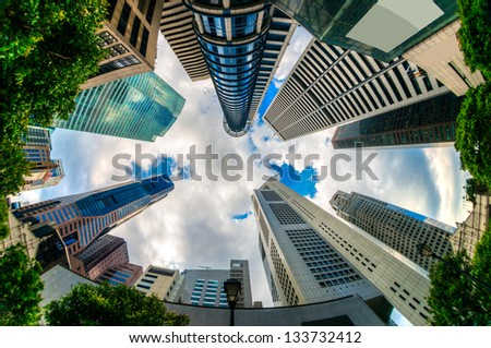 Fish-eye view of Singapore city skyline. - stock photo