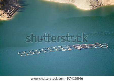 fish farm and boat - stock photo
