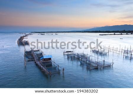 Fish farms at sunrise in chanthaburi,Thailand  - stock photo