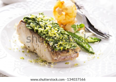 fish filet fired with herbs - stock photo