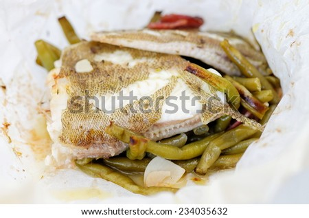 Fish Fillet with green beans, peas, parsley, olive oil and wine  - stock photo