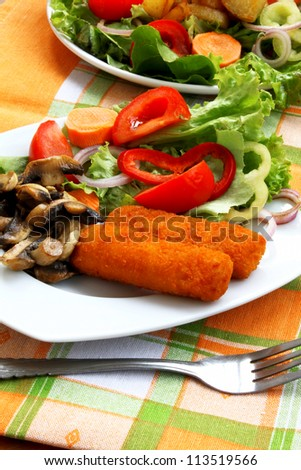 Fish fingers and salad