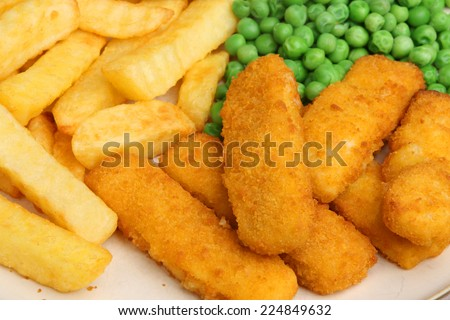 Fish fingers served with chips and peas. - stock photo