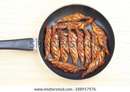 Fish fry in non stick pan. - stock photo
