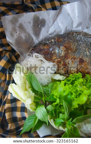 fish grilled with salt is thai food.it has many vegetable, noodles and spicy sauce(sea food sauce) - stock photo