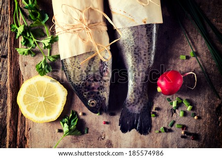 Fish head and tail from above on the wooden table  - stock photo