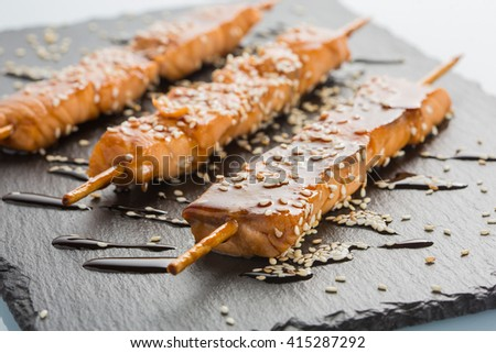fish kebabs. on a black slate plate. - stock photo