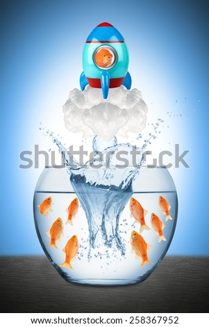 fish leaving fish bowl with rocket - stock photo