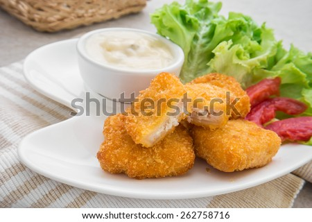 Fish nuggets and dip sauce on plate   - stock photo