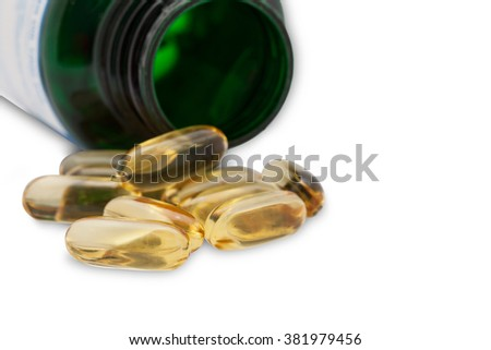 Fish oil capsules  and container on white background - stock photo