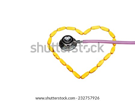 Fish oil capsules arranged in heart shape and stethoscope on white background - stock photo