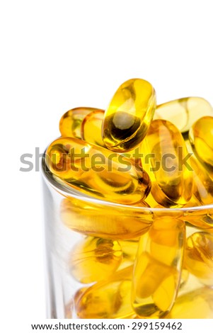 fish oil capsules close up on white background - stock photo