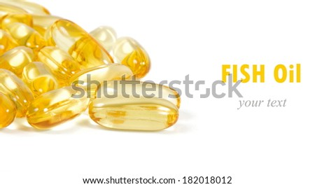 fish oil capsules with space for text - stock photo