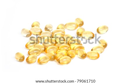 fish oil pills on white background - stock photo