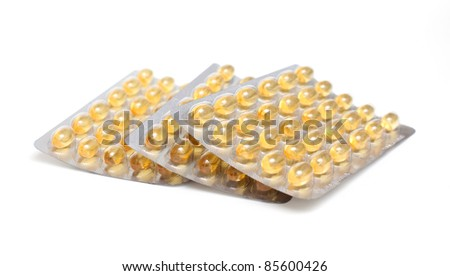 fish oil pills on white background