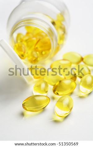 Fish Oil, scattering on white table. Small depth of field
