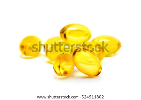 Fish oil supplement capsules source of omega3 selective focus in front object isolated on white background