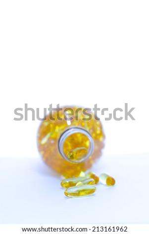 Fish oil vitamin on a white table - stock photo