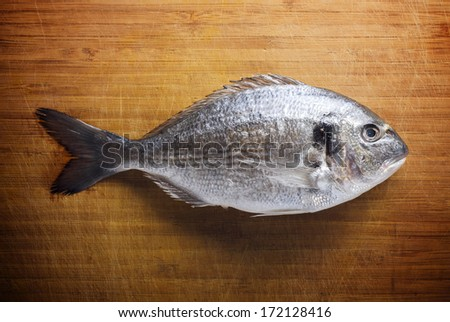 Fish on wooden background - stock photo