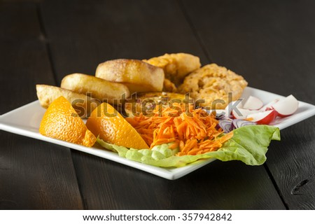 fish or fillets of chicken with vegetables - stock photo